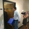 U.S. Senate candidate Thomas Ravenel (I-S.C.) carries a box of petitions into the S.C. Election Commission (SCEC).